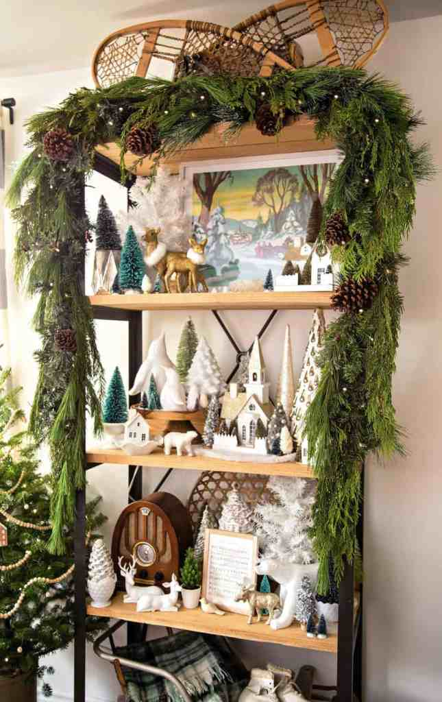 Tips for hanging garland in your home |How to Hang Garland by popular Canada DIY blog, Fynes Designs: image of garland hanging on a shelf decorated with various Christmas decor items.