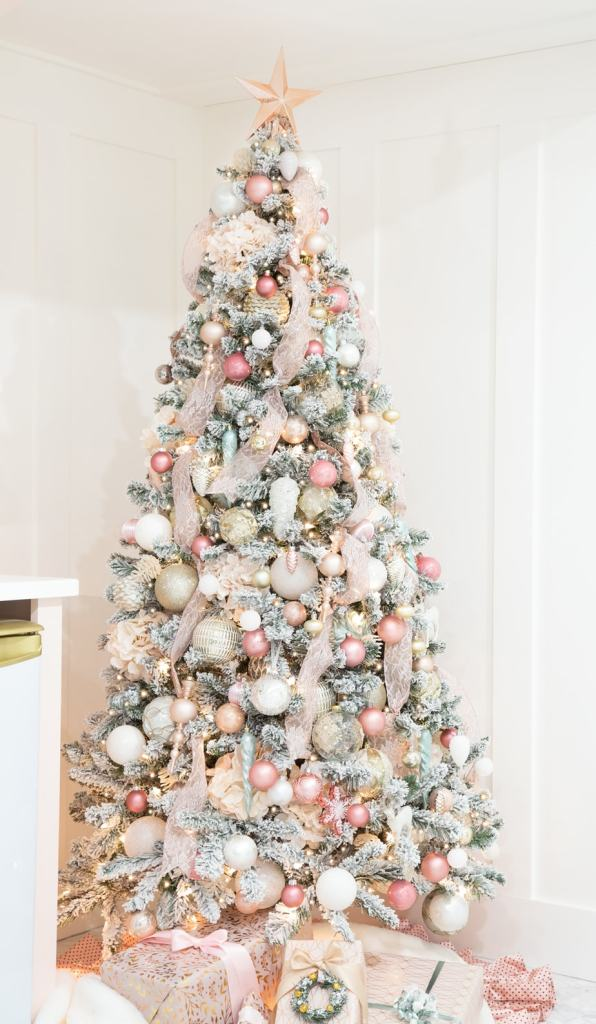 Step by step instructions how to Decorate a Christmas tree like a designer |Colorful Christmas Decorations by popular Canada Interior Design blog, Fynes Designs: image of a pink, gold, and white Christmas tree.