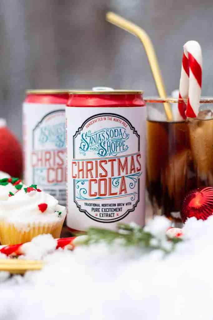 Personalize your Santa Soda with these free DIY Soda Can Labels |Bottle Labels by popular Canada DIY blog, Fynes Designs: image of soda cans with personalized labels.