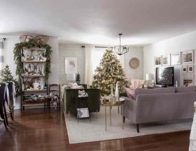 Open concept living room Christmas decorating ideas |Colorful Christmas Decorations by popular Canada Interior Design blog, Fynes Designs: image of a living room decorated with a pink and mint green Christmas tree, garland, and colorful Christmas tree decor.