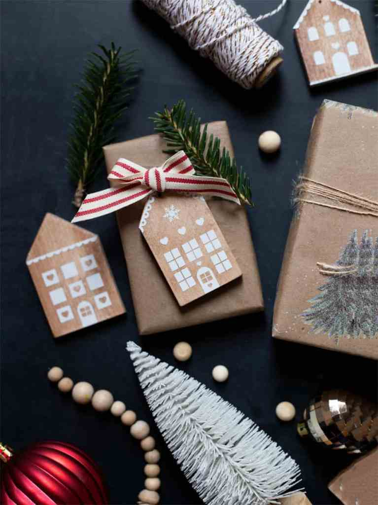 Wood Ornaments by popular Canada DIY blog, Fynes Designs: image of wooden gingerbread house ornaments.