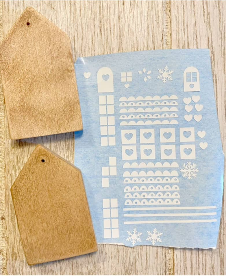 Download the free gingerbread house SVG to create fun wood ornaments.