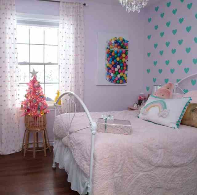 Girls bedroom Christmas Decorating |Colorful Christmas Decorations by popular Canada Interior Design blog, Fynes Designs: image of a girls bedroom with a mini pink Christmas tree.
