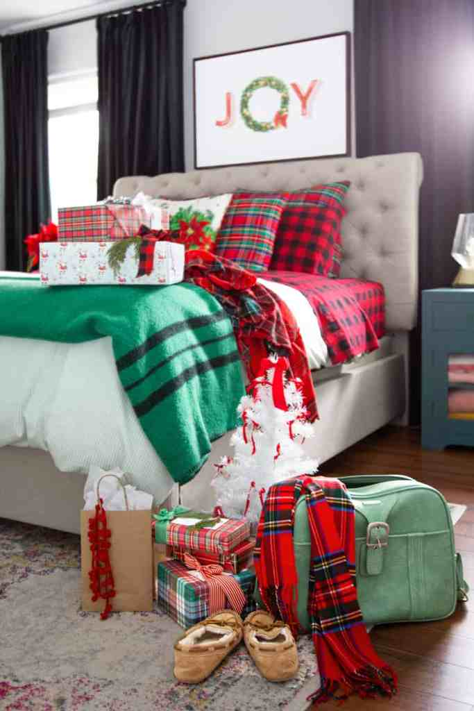Master bedroom Christmas decorating ideas |Colorful Christmas Decorations by popular Canada Interior Design blog, Fynes Designs: image of a bed with made with Christmas bedding.