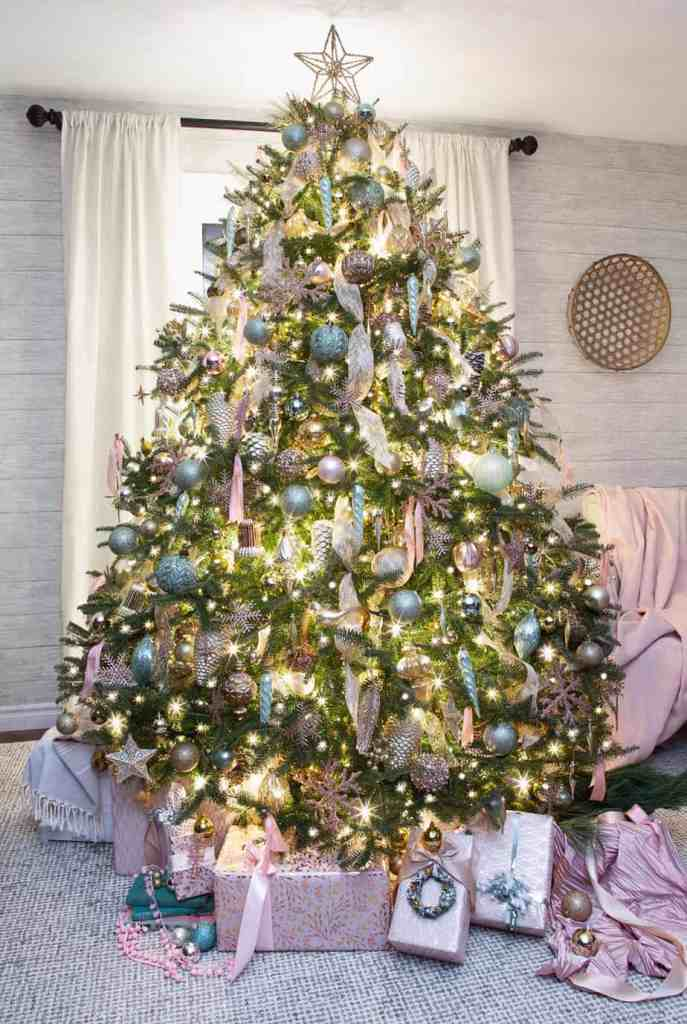 Real Christmas Tree Decorating ideas |Colorful Christmas Decorations by popular Canada Interior Design blog, Fynes Designs: image of a pink and mint green Christmas tree.