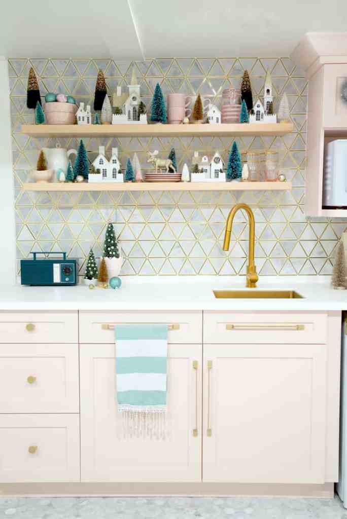 Vacation rental Christmas decorating ideas |Colorful Christmas Decorations by popular Canada Interior Design blog, Fynes Designs: image of floating kitchen shelves decorated with Christmas decor.