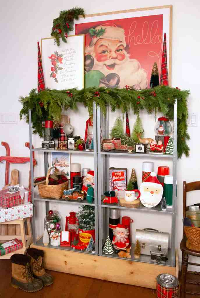 Vintage inspired Christmas vignette |Colorful Christmas Decorations by popular Canada Interior Design blog, Fynes Designs: image of a book case filled with vintage Christmas decor.