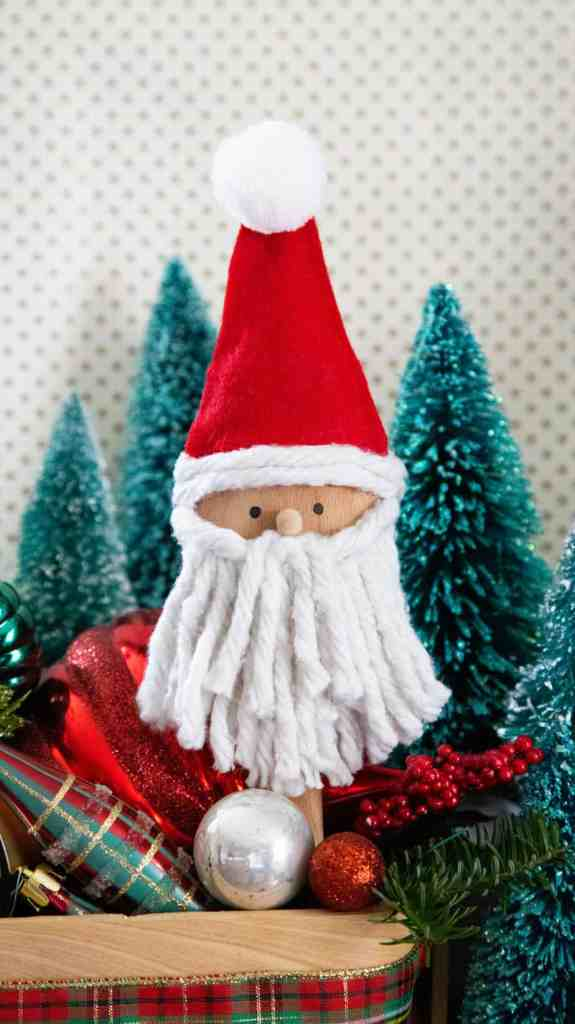 Wooden spoon Santa Christmas craft for kids |Kids Christmas Crafts by popular Canada DIY blog, Fynes Designs: image of a Santa wooden spoon craft.