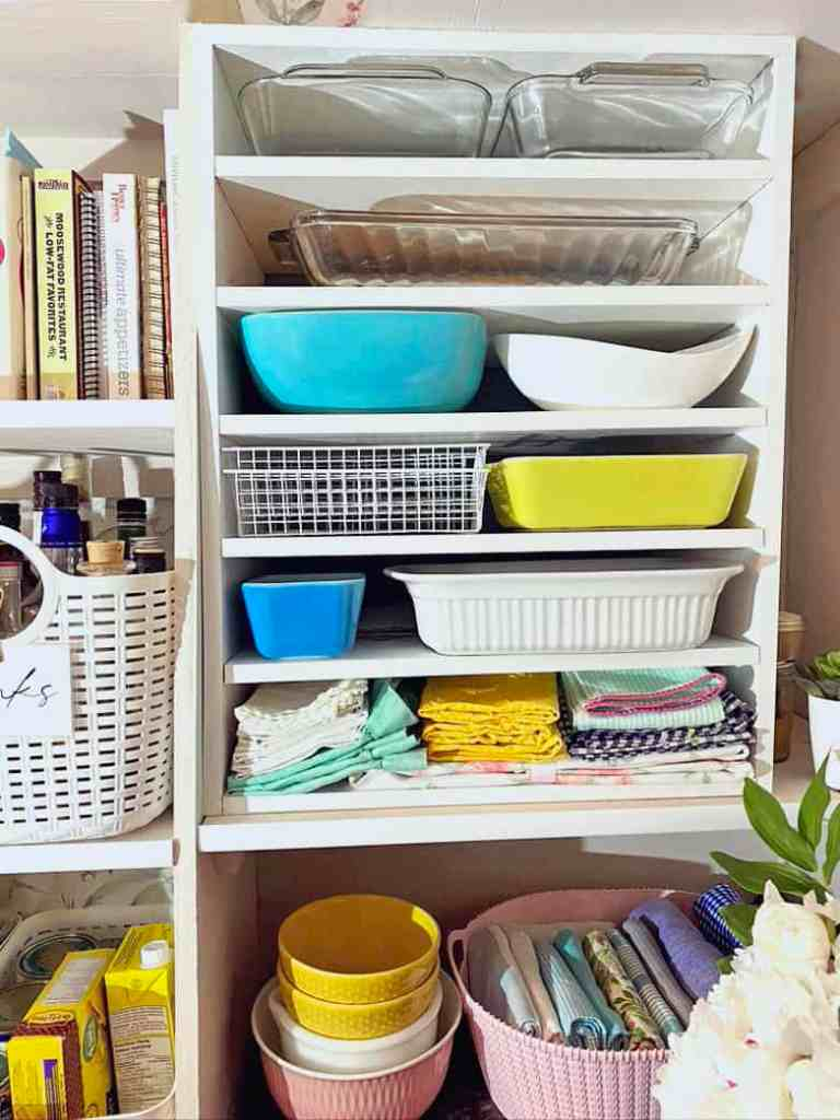 How to store casserole dishes in a pantry |Pantry Organization Tips by popular Canada interior design blog, Fynes Designs: image of organized casserole dishes.