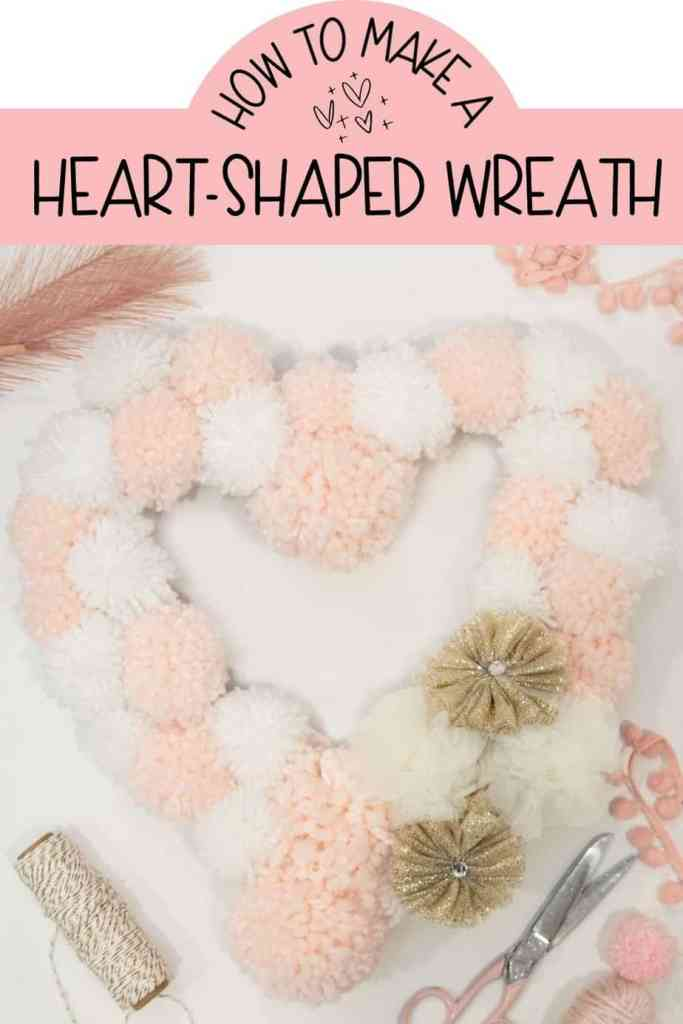 How to Make a Heart Shaped Wreath for less than $2! | Heart Shaped Wreath by popular Canada DIY blog, Fynes Designs: Pinterest image of a pink and white heart shaped pom pom wreath.
