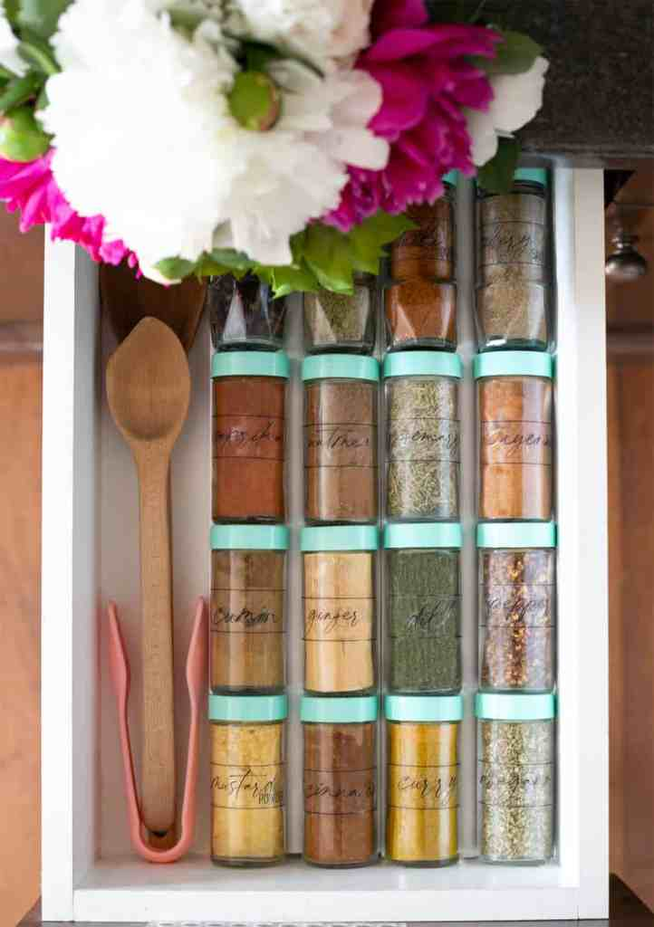 Free Kitchen Pantry Labels for bins and spice jars |Pantry Organization Tips by popular Canada interior design blog, Fynes Designs: image of spice jars with modern pantry labels.