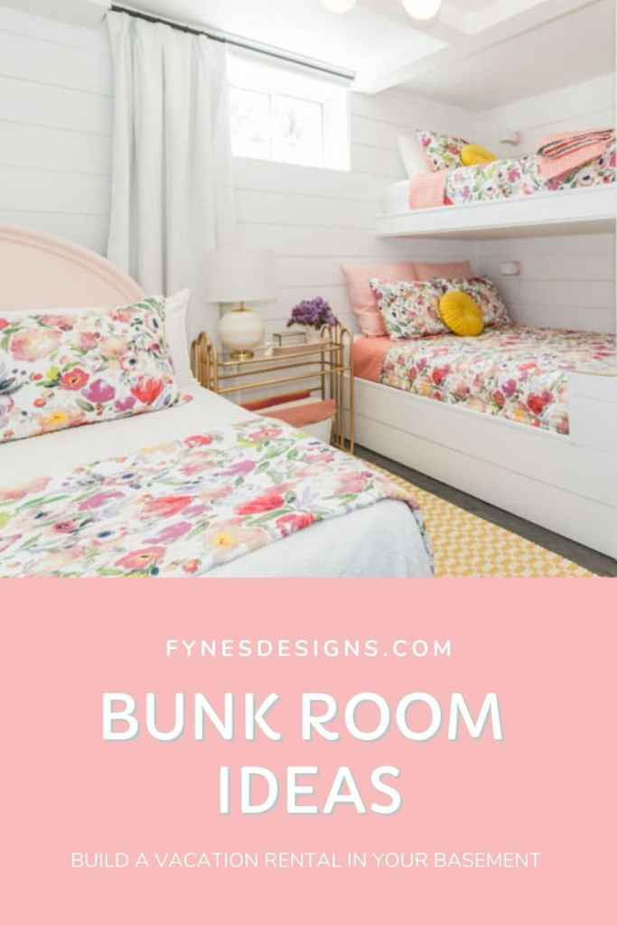 Basement Bunk Room Ideas for a cool Vacation Rental |  Bunk Room Ideas by popular Canada home design blog, Fynes Designs: image of a basement bunk room with white shiplap wall, mid century modern chandelier, bunk beds with floral bedding, white drapes, queen bed with a pink headboard and white and floral bedding, yellow and white checked runner rug and a gold metal and glass top side table with a white basket filled with blankets resting underneath.