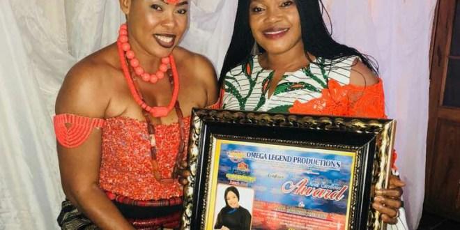 Pastor receiving award