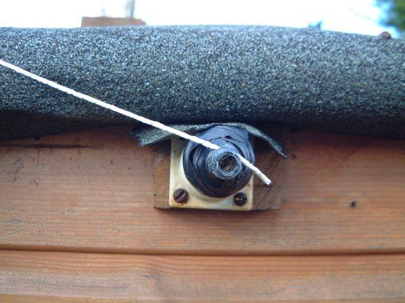 Wet string antenna on insulator
