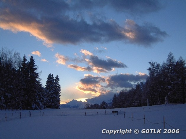 Sunset over snow covered field