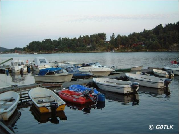 Boats moored to lakeside pontoon