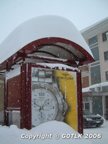 Heavy snow on bus shelter