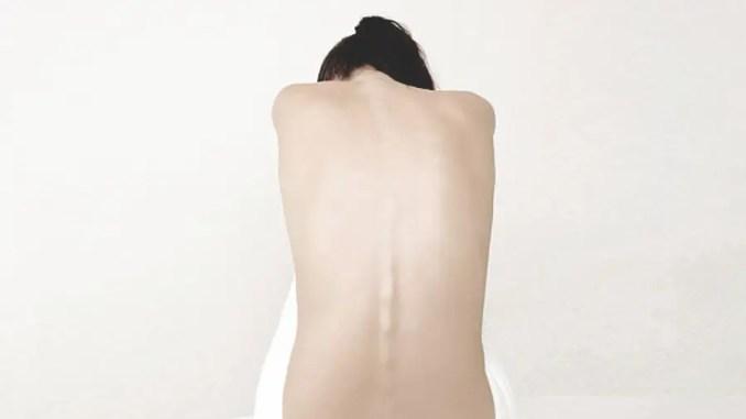 dolores de espalda en la mujer