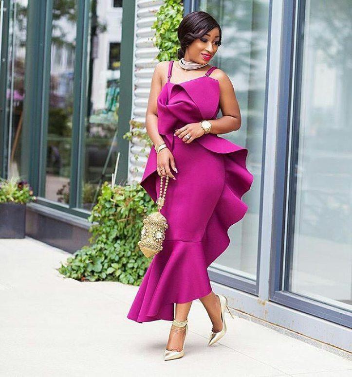 nigerian wedding guest with clutch purse