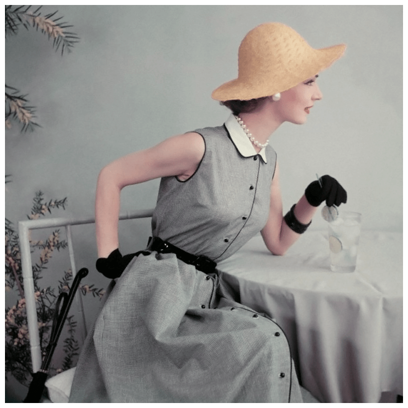 frances-mclaughlin-gill-model-in-black-and-white-gingham-dress-with-pique-collar-gloves-and-straw-hat-sipping-an-ice-cold-drink-garnished-with-limes-1952