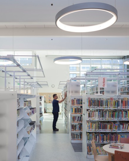 Lighting for the book stacks in the West Berkeley Public Library comes from built-in energy efficient light fixtures above the stacks rather than relying on general ambient lighting. (Photo by Mark Luthringer)