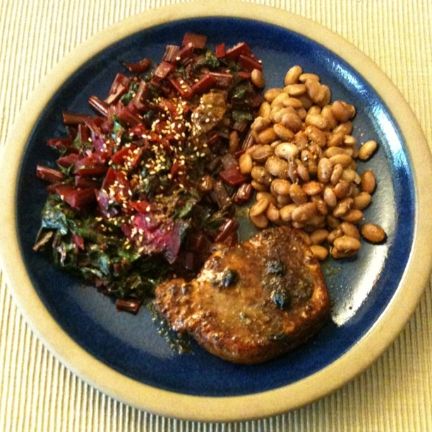 Pork loin, pinto beans and beet greens