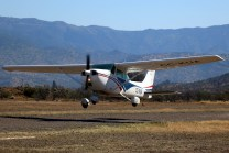 CUA flagship, Cessna 182 CC-KUA, rotating on an early morning flight (photo: Carlos Ay).