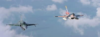 Flying together: brazilian F-5EM and venezuelan F-16A approaching C-130 (photo Rob Nispeling)