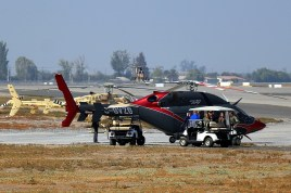 The two Bell Helicopter flying demonstrators take a break between customer rides as the OH-6i from Boeing demonstrator hovers into the FIDAE helipad (photo: Carlos Ay).