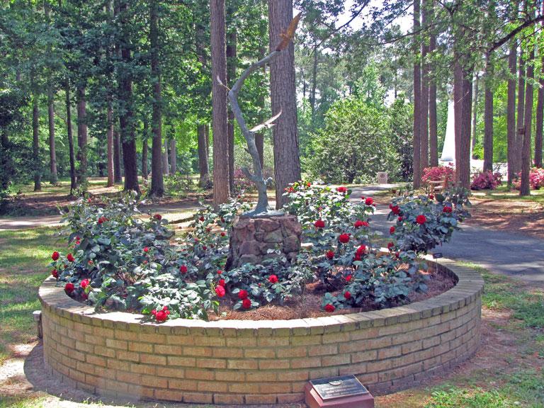 Brandt Memorial Garden with Europeana a floribunda rose, and a Sculpture with Eagles