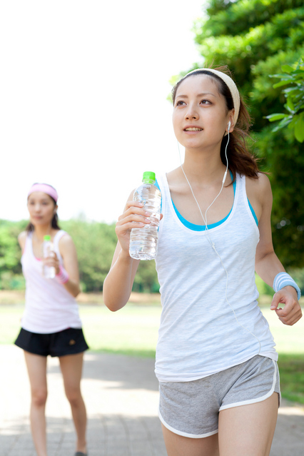 Beautiful young women running in park. Portrait of asian.