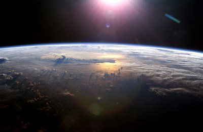 The Setting of the Sun Over the Pacific Ocean and a Towering Thundercloud, July 21, 2003. As Seen From the International Space Station (Expedition 7)