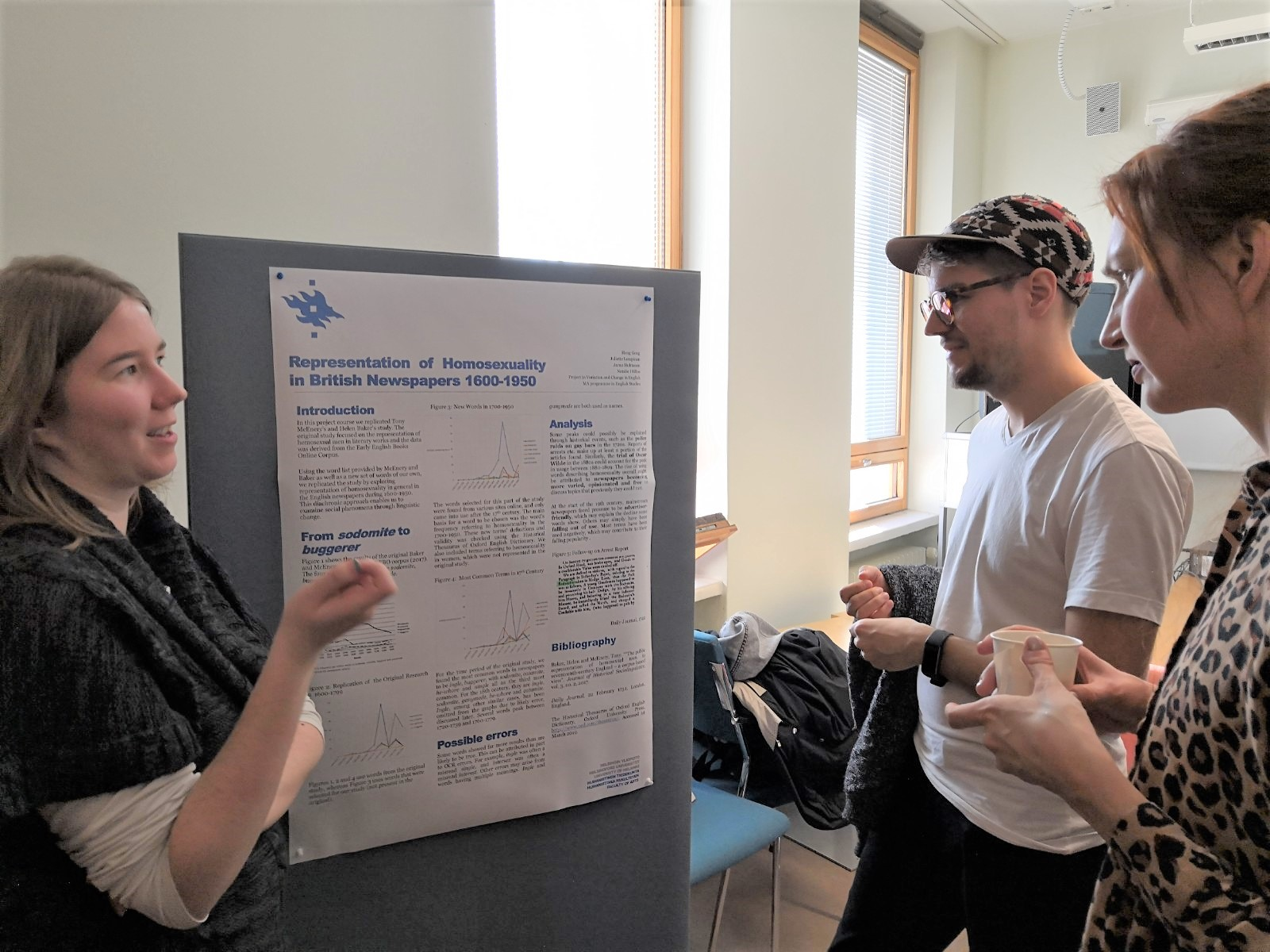 Students at Helsinki discuss an end of course poster which used the Gale Digital Scholar Lab.
