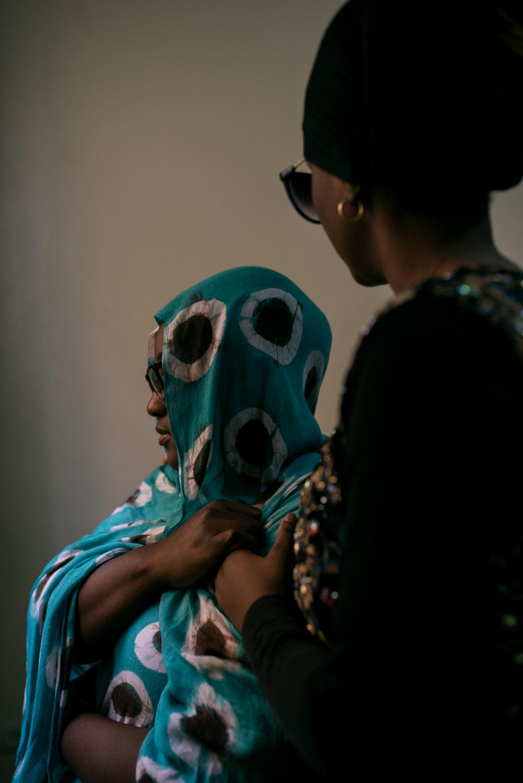 """Portrait of Diara (left) and Meriem.Diara, 21 years old, in couple with Meriem 20 years old, the two young women live their relationship in secret since two years, to see each other, they need to rent a room in a hostel in Nouakchott. Diara: """"I am an only child, my father took me out of school because I refused a marriage, and he threatens to kick me out of the house if I refuse the next one. I don't know how I'm going to do without an education or a job""""... """"we live in an Islamic country, I can't be myself""""... """"As a woman, I'm not free, I can't have my own apartment... I just want to live. I have a permanent pain that I can't even show"""".Portrait de Diara (à gauche de l'image) et Meriem.Diara, 21 ans, en couple avec Meriem 20 ans, les deux jeunes femmes vivent leur amour en cachette depuis deux ans, pour se voir, elles sont obligées de louer une chambre dans une auberge de Nouakchott. Diara: «Je suis fille unique, mon père m'a sorti de l'école car j'ai refusé un mari, et il me menace de me virer de la maison si je refuse le prochain. Je ne sais pas comment je vais faire sans études ni emploi» …«Ici c'est un pays islamique, je ne peux pas être moi même»…«En tant que femme, je ne suis pas libre, je ne peux pas avoir mon propre appartement… je souhaite juste vivre. J'ai une douleur permanente que je ne peux même pas montrer»."""
