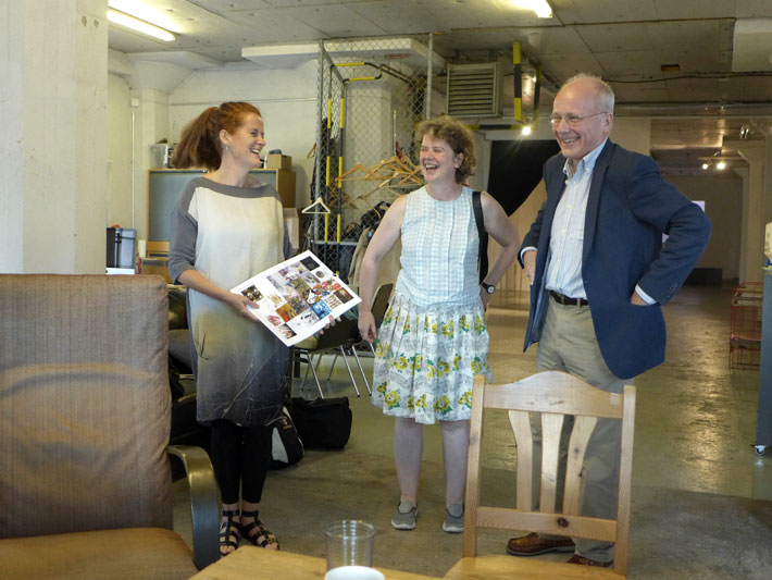 Maria Kerin and Fiona O'Dwyer giving the Two-year-calender made by Outrider Artists and Vedelik artists to the Irish Embassy Colm Ó Floinn