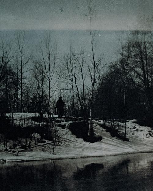 Man on Riverbank