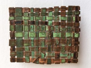 "Labour, Ours, 2014 3"" x 2"" Woven copper, text"