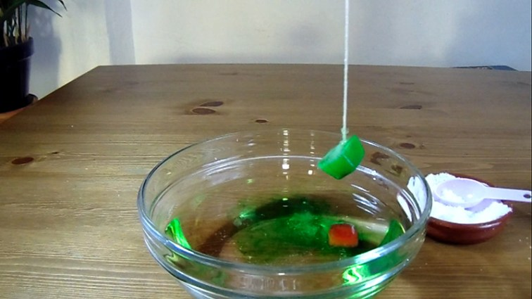 Step 4: And magic happens. After a few seconds, the ice cube gets lifted by the string.
