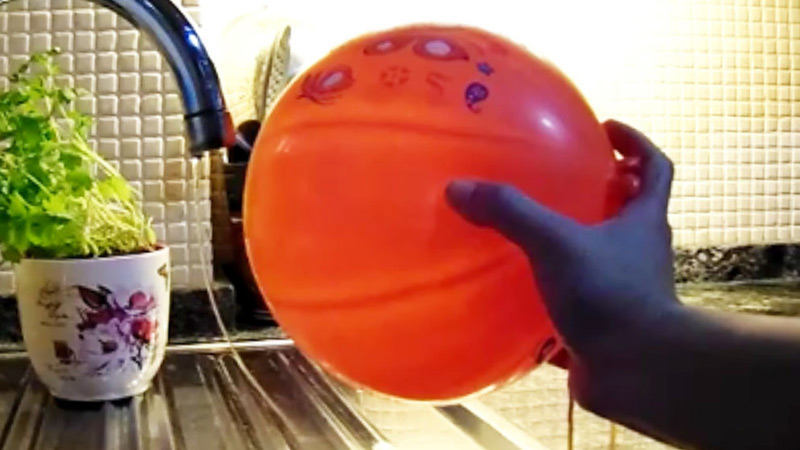 An experiment on static electricity, see how the water bends to this balloon.