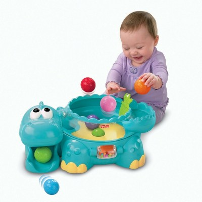 Fisher-Price Poppity Pop Musical Dino.- A dinosaur that pops balls and makes music.