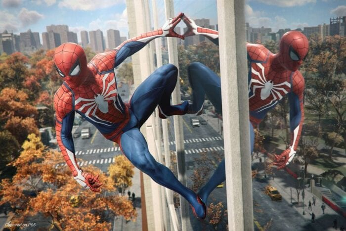 spider-man leaning on a building