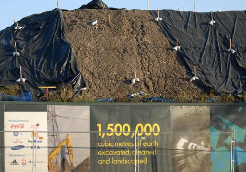 View of some of the mountains of material excavated for landscaping on the London Olympic Park