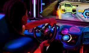man in black shirt driving car