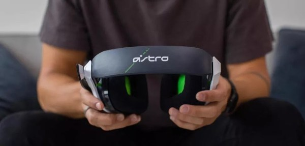 man showing ASTRO Gaming A20 Gen 2 Wireless Headset