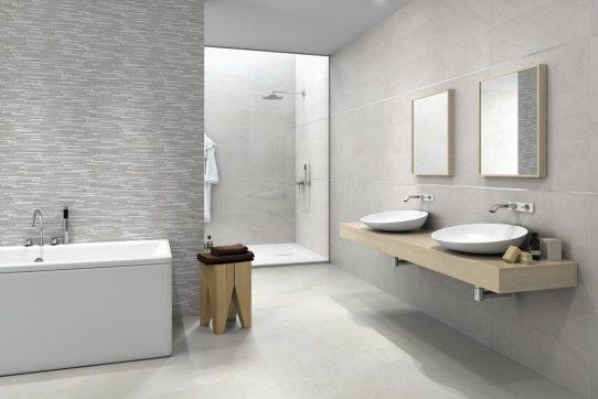 Cerámicas Terradecor HAUT-gris-en-baño. Con dos lavabos, bañera y ducha al fondo.