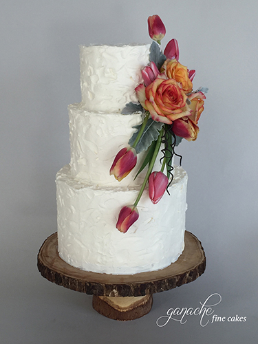 Stucco Buttercream Wedding Cake With Fresh Flowers