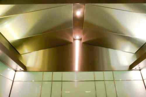 An angled ceiling with light troughs.