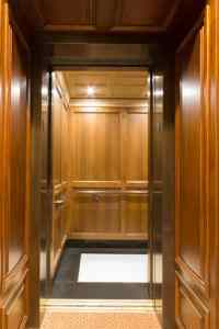 The Governor's car at the Minnesota State Capitol is a private elevator with stile and rail upper and lower panels. The handrails are composed of extruded bronze.