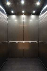 Photo of custom elevator interiors that service the parking garage at 365 Nicollet, Minneapolis, MN. Elevator Cab Modernization