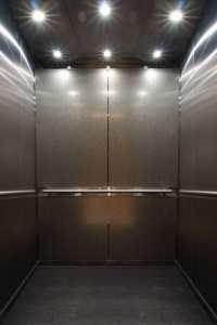 Photo of custom elevator interiors that service the parking garage at 365 Nicollet, Minneapolis, MN. Elevator Cab Modernization